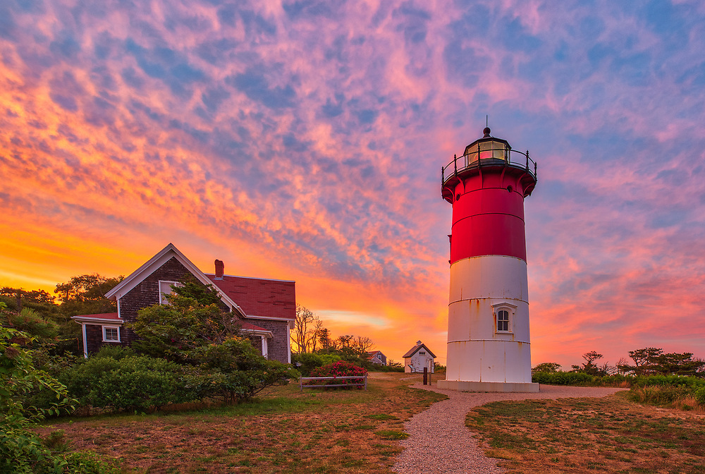 Nauset Light is one of the most iconic Cape Cod lighthouses. It is located in the town of Eastham, Massachusetts next to Nauset Beach and not far from Coastguard Beach along the Cape Cod National Seashore. Visiting Cape Cod and the Islands is always a lot of fun. I finally was able to head out to photograph Nauset Lighthouse at sunset when the sky exploded into beautiful colors. <br /> New England Cape Cod lighthouse fine art photography images are available as museum quality photography prints, canvas prints, acrylic prints or metal prints. Fine art prints may be framed and matted to the individual liking and decorating needs:<br /> <br /> https://juergen-roth.pixels.com/featured/cape-cod-nauset-lighthouse-juergen-roth.html<br /> <br /> All New England photos are available for photography image licensing at www.RothGalleries.com. Please contact Juergen with any questions or request. <br /> <br /> Good light and happy photo making!<br /> <br /> My best,<br /> <br /> Juergen
