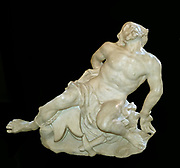 Giovanni Lorenzo Bernini 1598-1680.  Neptune and Triton circa 1622.  This work was one of the most celebrated sights in Rome.  It shows Neptune, god of the seas with his son Triton who was a merman.  Marble