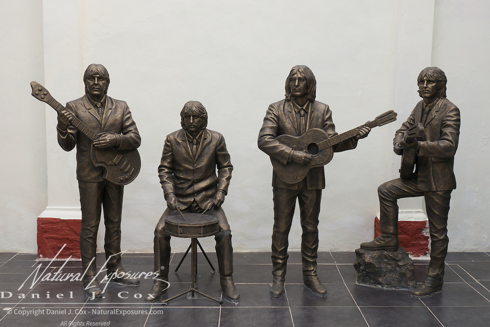 The Beatles immortalized in  life sized, bronze sculptures displayed at the Trinidad bar known as Yesterday. Cuba.