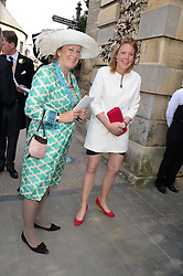 TOR INSKIP and her mother at the wedding of Lady Natasha Rufus Isaacs to Rupert Finch held at St.John The Baptist Church, Cirencester, Gloucestershire, UK on 8th June 2013.