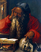 St Jerome', 1521, oil on panel , Albrecht Durer (1471-1528) German painter and printmaker.  St Jerome (c340-420) a father of Western Christian  Church and compiler of the Vulgate. Human skull, a memento mori, forked beard, ink well, quill pen.