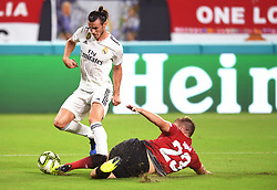 July 31, 2018 - Miami Gardens, FL, USA - Luke Shaw of Manchester United makes a sliding tackle on Gareth Bale of Real Madrid in the first half during International Champions Cup action at Hard Rock Stadium in Miami Gardens, Fla., on Tuesday, July 31, 2018. Manchester United won, 2-1. (Credit Image: © Jim Rassol/TNS via ZUMA Wire)