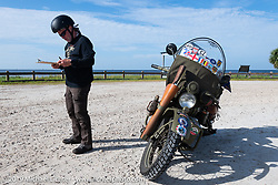 Gary Shorman answers a pop quiz during the Cross Country Chase motorcycle endurance run from Sault Sainte Marie, MI to Key West, FL. (for vintage bikes from 1930-1948). 287 mile ride of Stage-8 from Tallahassee to Lakeland, FL USA. Friday, September 13, 2019. Photography ©2019 Michael Lichter.