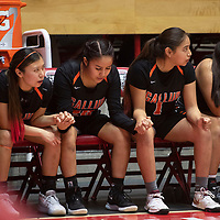 The Gallup Bengals bench hold hands late in the fourth quarter against the Kirtland Central Broncos during their 4A girls NMAA State Basketball quarterfinal playoff game at Dreamstyle Arena (The Pit) Tuesday night in Albuquerque. The Broncos beat the Bengals 61-54 to advance to the semifinal round.