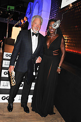 SIR TOM JONES winner of the GQ Legend of The Year Award GRACE JONES who presented the award at the GQ Men of The Year Awards 2012 held at The Royal Opera House, London on 4th September 2012.