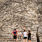 A family of tourists stop part way up the 120 steps of La Iglesia at Coba, an expansive Mayan site on Mexico's Yucatan Peninsula not far from the more famous Tulum ruins. Nestled between two lakes, Coba is estimated to have been home to at least 50,000 residents at its pre-Colombian peak.