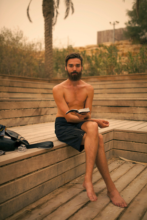 Pilgrim Mateo Black prays prior to his first ever Baptism in the water of the Jordan River, at the Quaser El YAhud baptism site on the Israeli Jordanian border. An unusual hazy weather was covering some parts f the middle east, with a very high concentration of particles in the air, on September 8, 2015.