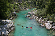 Canoeists paddle through the Soca Gorge on the Soca River, on 21st June 2018, in Kobarid, Slovenia.