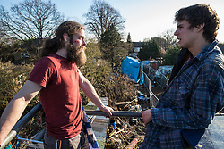 London, UK. 26th February, 2019. Residents of Grow Heathrow look down from an observation tower on the squatted eco-community founded in 2010 on a previously derelict site close to Heathrow airport in protest against government plans for a third runway. The community has since developed an extensive garden and is acknowledged to have made a significant educational and spiritual contribution to life in the Heathrow villages which are threatened by airport expansion. Bailiffs from the National Eviction Team have today partially evicted the site, almost securing the front section of the site, owned by Imran Malik, removing several protesters locked on in towers above the camp, but four protesters are believed to remain in a tunnel beneath that area.