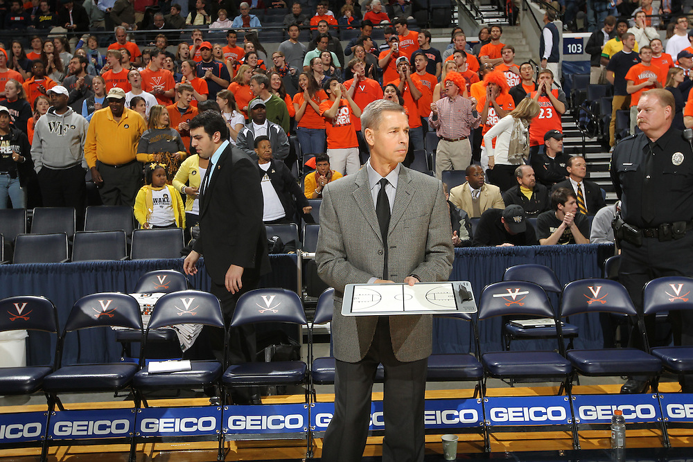 Wake Forest head coach Jeff Bzdelik prepares before the start of the game against Virginia Wednesday Jan. 08, 2014 in Charlottesville, Va. Virginia defeated Wake Forest 74-51.