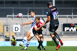 Tom de Glanville clears the ball past the referee and  Wilhelm Van Der Sluys  - Ryan Hiscott/JMP - 09/09/2018 - RUGBY - Sandy Park - Exeter, England - Exeter Braves v Bath United, Premiership Rugby Shield