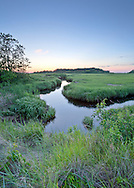 A still evening on Stoney Brook and the marshes surrounding Wing Island at the Cape Cod Museum of Natural History in Brewster.