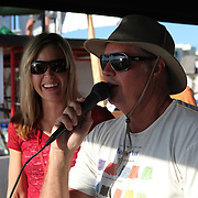Event emcee Greg Taylor calls the action during the 28th annual National Kidney Foundation, Rich Salick Pro/Am surf festival takes place at the the Cocoa Beach pier on Saturday,  September 2, 2013 in Cocoa Beach, Florida. This event raises thousands of dollars for people with kidney disease and also benefits the services of the NKF of Florida. (AP Photo/Alex Menendez)
