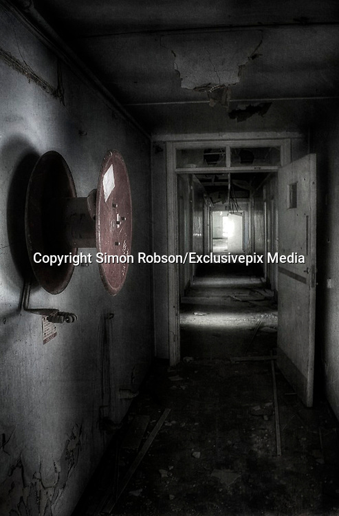 """Abandoned creepy pictures  of inside the former RAF Hospital<br /> used as a place for burns victims during the Second World War.<br /> <br /> Empty hallways and graffitied walls are some of the sights that have been photographed at the former Rauceby Hospital site.<br /> <br /> Photographer Simon Robson has been inside the former mental hospital which was also used as a place for burns victims during the Second World War.<br /> <br /> Mr Robson, who is from Lincoln, said he wanted to photograph the site because it was a former asylum. He said: """"I like the idea of going round a former asylum as it has more character about it.<br /> <br /> """"It was gutted on the inside, there were empty rooms and no furniture.<br /> He added an old hospital bed was something that he will remember from the site.<br /> <br /> """"When I went in the old chapel part there was an old hospital bed left in there which was quite creepy at the time.<br /> <br /> """"I don't think about where I am too much and stay in my own world of photography.""""<br /> <br /> The hospital originally opened in 1902 and the buildings included a chapel, two graveyards, a mortuary, and various tunnels connecting wards.<br /> The South Lincolnshire Community and Mental Health Services NHS Trust closed the main hospital building in 1997, but kept on Orchard House as the Trust's headquarters.<br /> <br /> Mr Robson added: """"I think it's places where people don't get to see inside that are fascinating - it's a fascination with the unknown.""""<br /> <br /> The 35-year-old from Lincoln said he was inspired to photograph places such as the former Rauceby Hospital site after seeing other photographs on online forums.<br /> <br /> He added that he always been interested in photography it was the subject of his degree, but admits it's more of a hobby for him now.<br /> ©Simon Robson/Exclusivepix Media"""