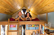 Deb Delman and Kol Peterson, owners of the Caravan Tiny House Hotel, inside the tiny house called Kangablue, Portland, OR, USA