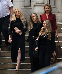 © Licensed to London News Pictures.<br /> 28/07/2020.  London, UK. American actress AMBER HEARD leaves the High Court in central London where Johnny Depp is in a legal dispute with UK tabloid newspaper The Sun over allegations he assaulted his former wife, Amber Heard. Photo credit: Marcin Nowak/LNP