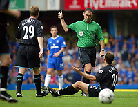 Photograph: Scott Heavey.<br />Chelsea v Leicester City, from Stamford Bridge. 23/08/2003.<br />Referee, Rob Styles gives Riccardo Scimeca his marching orders.