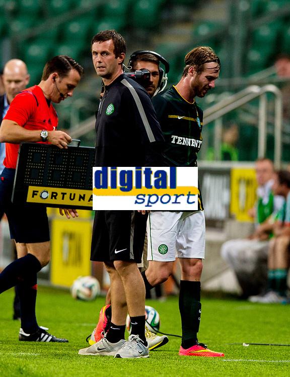30/07/14 UEFA CHAMPIONS LEAGUE THIRD ROUND QUALIFIER FIRST LEG<br /> LEGIA WARSAW V CELTIC<br /> PEPSI ARENA - WARSAW<br /> Celtic manager Ronny Deila (left) and new signing Inge Jo Berget.