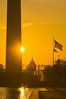 Sunrise over the Reflecting Pool with the Washington Monument and U.S. Capitol behind, Washington D.C., U.S.A.