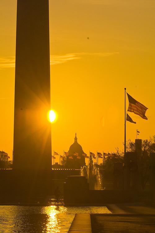 Sunrise over the Reflecting Pool with the Washington Monument and U.S. Capitol behind, Washington D.C., U.S.A.