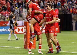 March 10, 2018 - Vancouver, British Columbia, U.S. - VANCOUVER, BC - MARCH 10: Justin Douglas (#8) of Canada congratulated by Harry Jones (#11) and the Canadian team during Game # 23- Canada vs Uruguay Pool A match at the Canada Sevens held March 10-11, 2018 in BC Place Stadium in Vancouver, BC. (Photo by Allan Hamilton/Icon Sportswire) (Credit Image: © Allan Hamilton/Icon SMI via ZUMA Press)