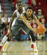 Feb 16, 2013; Fayetteville, AR, USA; Missouri Tigers uard Phil Pressey (1) reaches to keep the ball from Arkansas Razorbacks guard Mardracus Wade (1) during the first half at Bud Walton Arena.  Mandatory Credit: Beth Hall-USA TODAY Sports