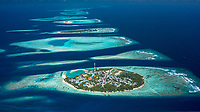 Aerial view of local, inhabited island Felidhoo, located in Vaavu Atoll, Maldives, Indian Ocean and the neigbor island Thinadhoo in the distance