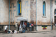 Addis Ababa, Ethiopia - August 1, 2010: Ethiopians pray outside a church in Addis Ababa.