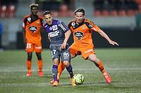 Adrien REGATTIN / Medhi MOSTEFA - 18.04.2015 - Lorient / Toulouse - 33eme journee de Ligue 1<br />Photo : Vincent Michel / Icon Sport