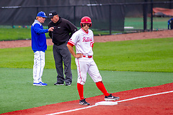 NORMAL, IL - May 01: Mitch Hannahs discusses a call with umpire Mark Huesman as Joe Butler was called safe at a close play during a college baseball game between the ISU Redbirds and the Indiana State Sycamores on May 01 2019 at Duffy Bass Field in Normal, IL. (Photo by Alan Look)