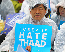 June 24, 2017 - Seoul, South Korea - A demonstrator attend a protest against the deployment of THAAD in Seoul. Thousands of South Korean protestors against the deployment of the U.S. Terminal High Altitude Area Defense (THAAD) in their homeland took to the streets in central Seoul to demand the reversal of the installation decision. (Credit Image: © Yao Qilin/Xinhua via ZUMA Wire)