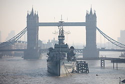 © Licensed to London News Pictures. 27/02/2019. London, UK. Smog is seen behind Tower Bridge in London this morning, following days of unseasonably warm weather in the capital. Temperatures on Tuesday 26 February reached 20.8C in Porthmadog, north-west Wales, which was the warmest winter day on record. Photo credit : Tom Nicholson/LNP