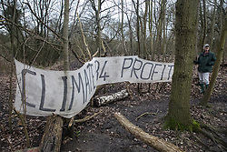 Harefield, UK. 13 January, 2020. Stop HS2 activists occupy a protection camp close to Harvil Road. Part of the nearby Colne Valley protection camp was evicted by bailiffs last week. 108 ancient woodlands are set to be destroyed by the high-speed rail link and further destruction of trees for HS2 in the Harvil Road area is believed to be imminent.