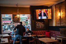 © Licensed to London News Pictures. 20/03/2020. London, UK. Drinkers at the Pocket Watch react during the government's announcement that all pubs and restaurants  will be closing tonight indefinitely, pending monthly review.  Photo credit: Guilhem Baker/LNP
