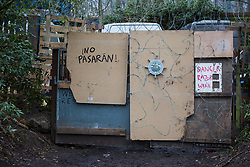 Wendover, UK. 18th March, 2021. The words 'No Pasaran' are pictured on the exterior of Stop HS2's Wendover Active Resistance Camp in woodland threatened by the HS2 high-speed rail link project. Activists opposed to HS2 have set up several such camps along the Phase One route of the £106bn rail link between London and Birmingham.
