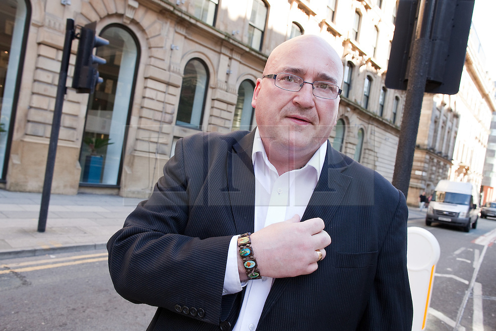 © Licensed to London News Pictures .  08/09/2012 . Manchester, UK . Domenyk Noonan , recently released from prison , at the scene of his 9th August 2011 arrest , on Aytoun Street in Manchester . The area was the scene of looting and rioting on 9th August 2011 , during which Noonan was arrested . Noonan has announced he plans to sue the police over the  arrest . Under the terms of a previous early release , the arrest lead to him being recalled to prison . Photo credit : Joel Goodman/LNP
