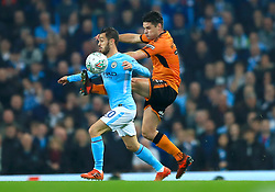 Manchester City's Bernado Silva (left) and Wolverhampton Wanderers' Ben Marshall battle for the ball during the Carabao Cup, Fourth Round match at the Etihad Stadium, Manchester.