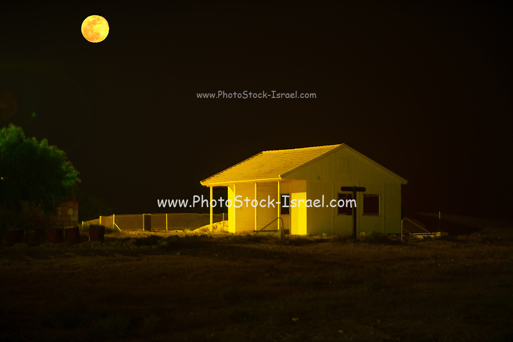 Moon lit remote cabin at night