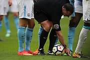 Referee, Neil Swarbrick marks the spot for a free kick during the Premier League match between West Ham United and Manchester City at the London Stadium, London, England on 29 April 2018. Picture by Toyin Oshodi.