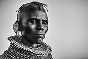 A portrait in black and white of a Turkana women wearing traditional stacked beaded necklaces, Lake Turkana, Loiyangalani,Kenya, Africa