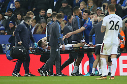 Leicester City's Harry Maguire consoles injured Burnley player Robbie Brady
