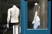 As it is reported that a further 428 people have died with Covid-19 in the UK, the total number of deaths in hospitals and the wider community to 33,614, clothing mannequins stand with their backs to the street, in the window of a menswear retailer in Jermyn Street, on 14th May 2020, in London, England.
