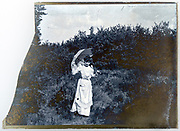early 1900s fashionable dressed young adult woman with umbrella France
