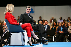 © Licensed to London News Pictures. 04/10/2021. Manchester, UK.  Leader of the House of Commons Jacob Rees-Mogg speaks to MP for Bishop Auckland Dehenna Davison at the Conservative Party Conference on Monday. The annual Conservative Party Conference has returned to Manchester this year after being held online in 2020. Photo credit: Adam Vaughan/LNP