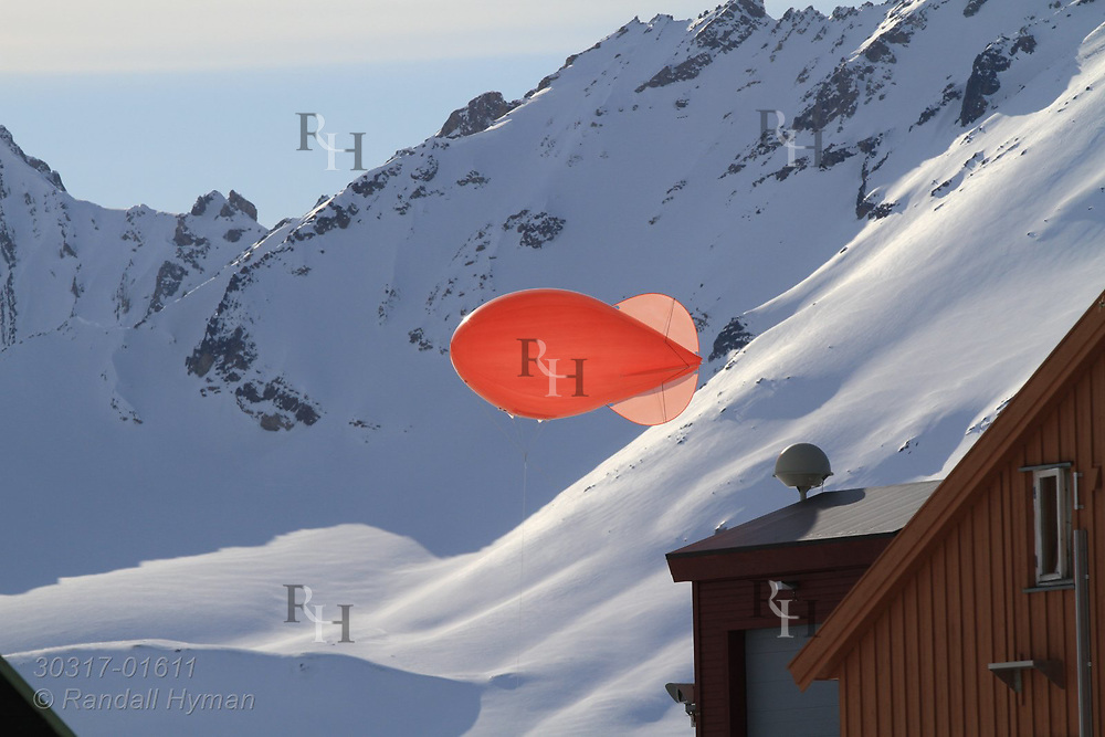 Tethered weather blimp floats near the French-German AWIPEV research station in the international science village of Ny-Alesund on Spitsbergen island in Kongsfjorden; Svalbard, Norway.