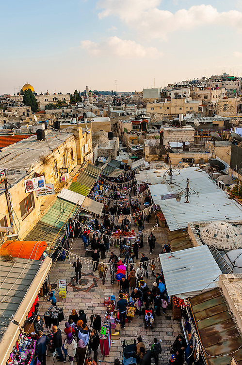 Overview of the street market on El Wad Road in the  Old City, near the Damascus Gate, seen from the 16th century ramparts, Jerusalem, Israel.