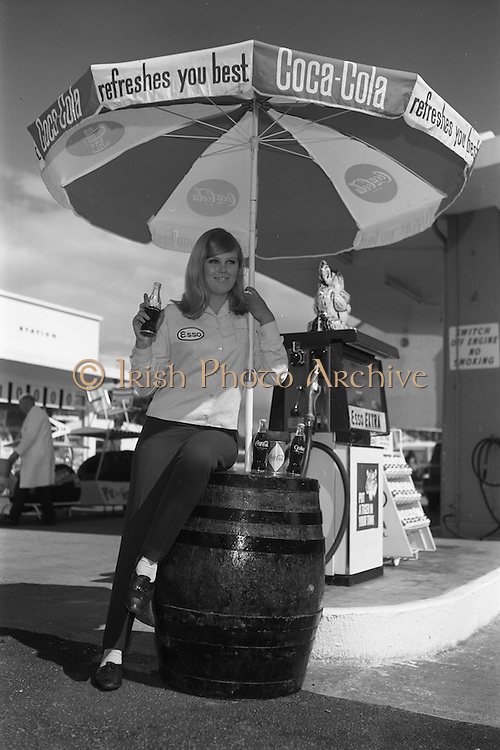 18/05/1966<br /> 05/18/1966<br /> 18 May 1966<br /> Coca-Cola girl advertisement at Esso Belmont Service Station Sandford Road, Dublin.