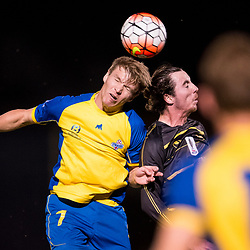 BRISBANE, AUSTRALIA - AUGUST 26: Michael Lee of the Strikers and Byron Sinnerton of Moreton Bay compete for the ball during the NPL Queensland Senior Men's Semi Final match between Brisbane Strikers and Moreton Bay Jets at Perry Park on August 26, 2017 in Brisbane, Australia. (Photo by Patrick Kearney)
