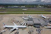 Aerial view (looking northwards from control tower) showing expanse of airport land with airliners at London Heathrow.