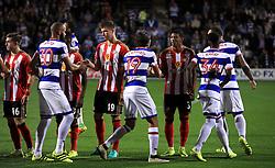 Sunderland's Patrick van Aanholt (third right) shakes hands with Queens Park Rangers' Abdenasser El Khayati before kick-off in the EFL Cup, Third Round match at Loftus Road, London.